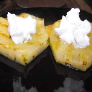 grilled pineapple topped with cream