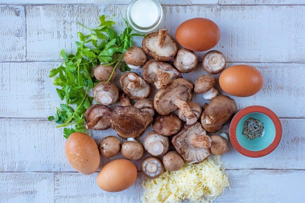 Mushrooms, surrounded by eggs, cheese, milk and herbs