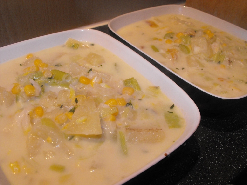 Two bowls of smoked haddock chowder on a table