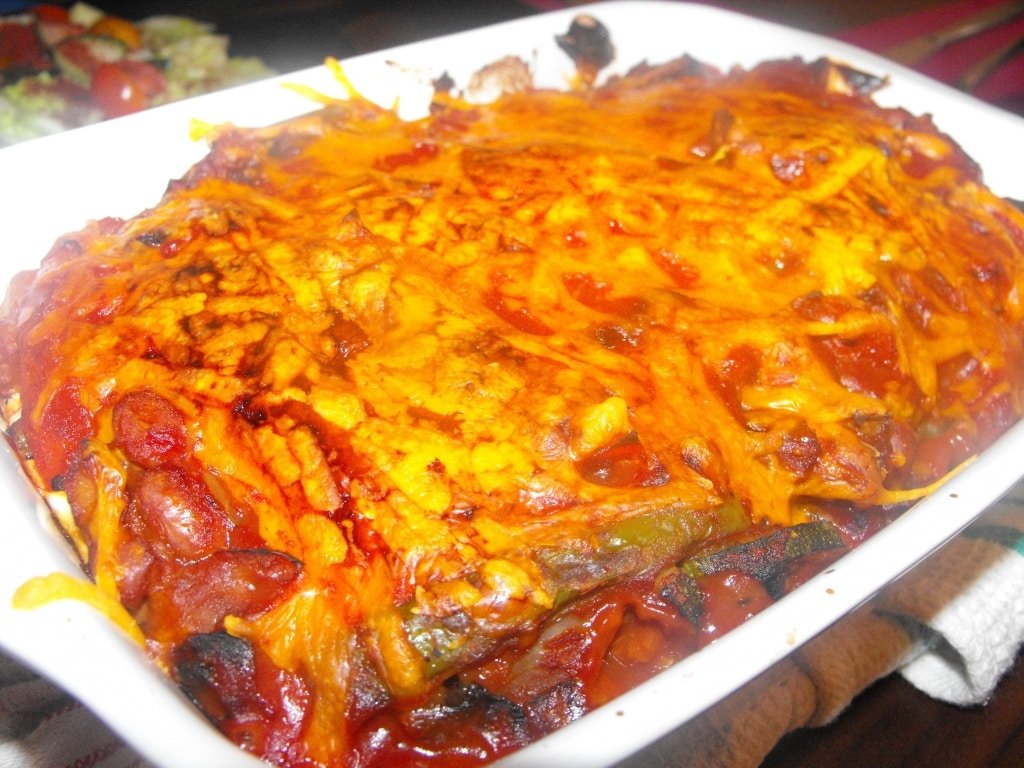 Vegetable Enchiladas in a white baking dish