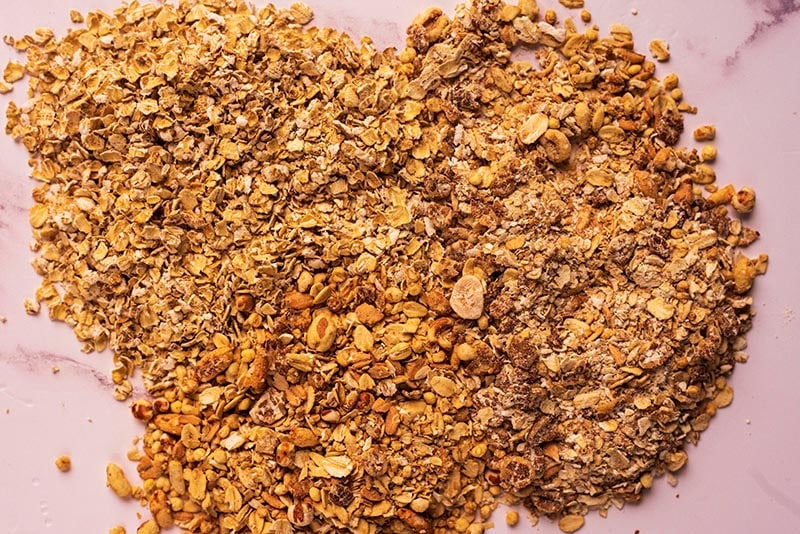 Oats and cereals all mixed together on a marble surface