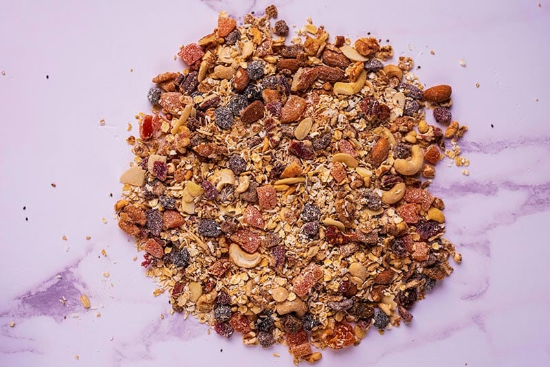 Homemade muesli all mixed together on a marble surface