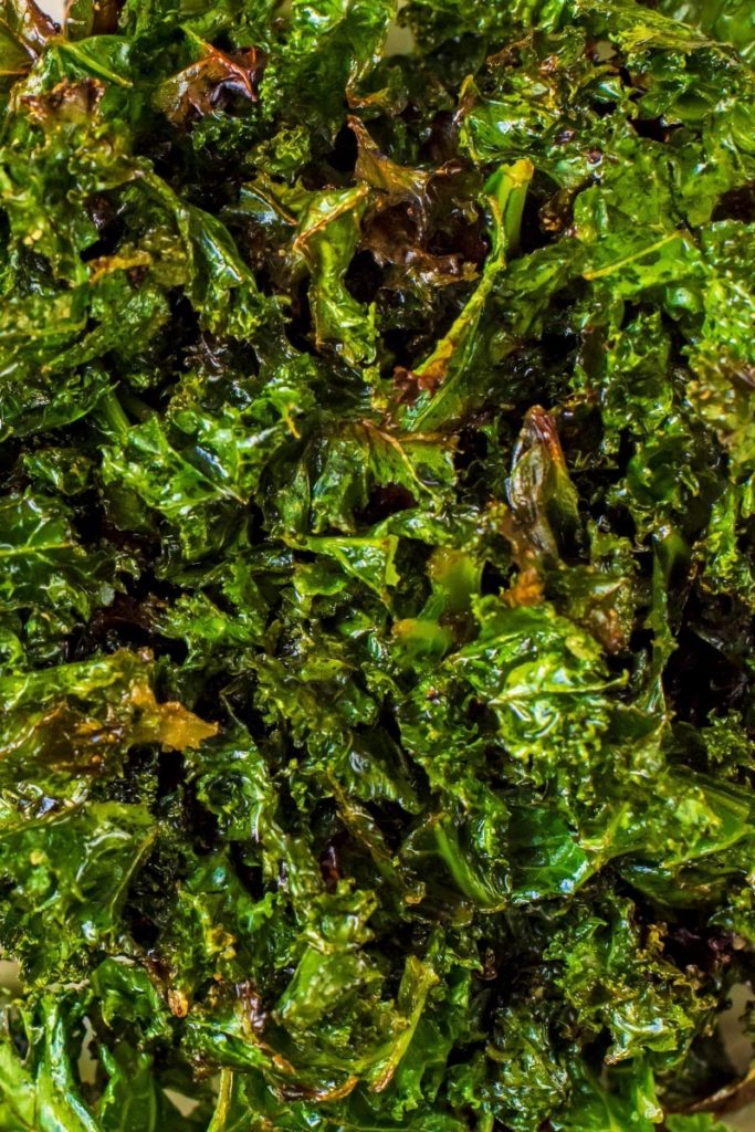 Crispy cooked leaves of kale with a coating of oil