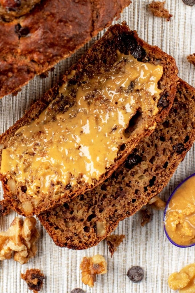 A slice of Healthy Banana Bread spread with peanut butter
