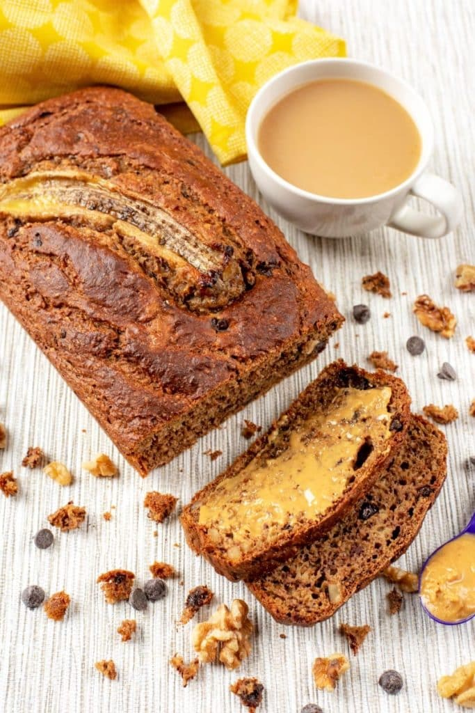 Banana bread next to a cup of tea