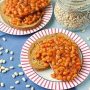 Two plates of Slow Cooker Baked Beans on toast