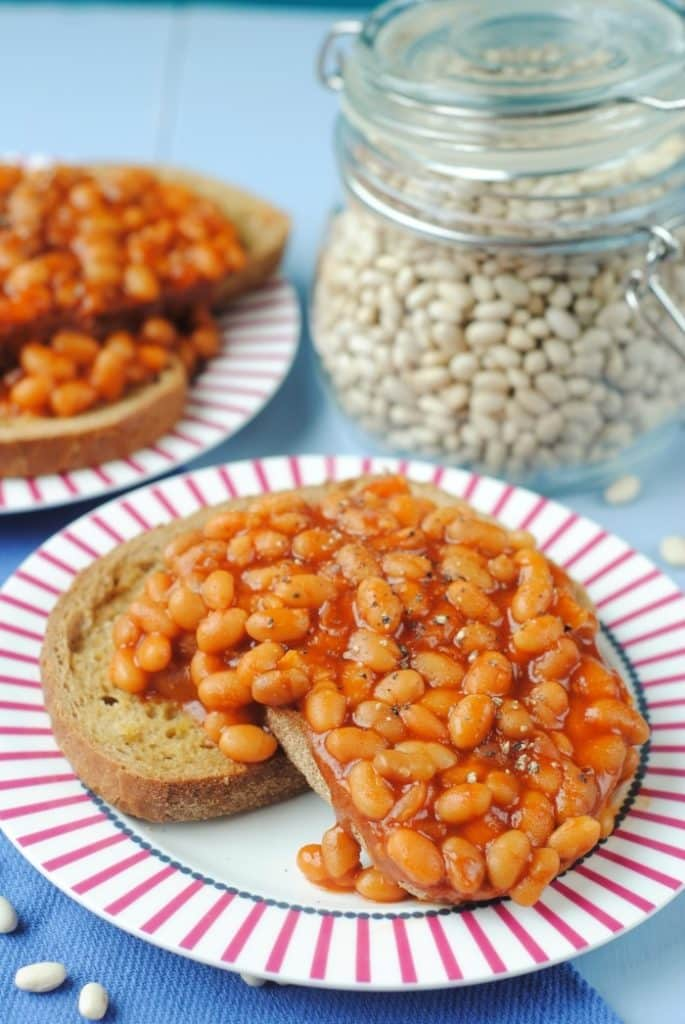 Slow Cooker Baked Beans on a red and white plate
