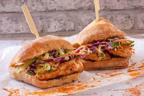 Two Cajun Chicken Burger on grease proof paper