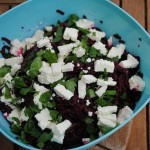 Beetroot and goats cheese salad in a blue mixing bowl