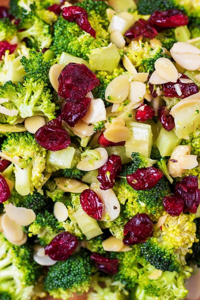 Raw broccoli florets, dried cranberries and flaked almonds all mixed together