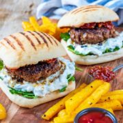 Spiced Lamb Burger on a serving board with fries