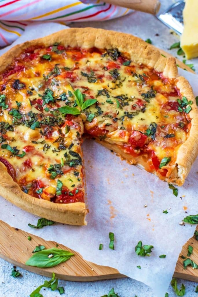 Deep Dish Pizza with slice cut out