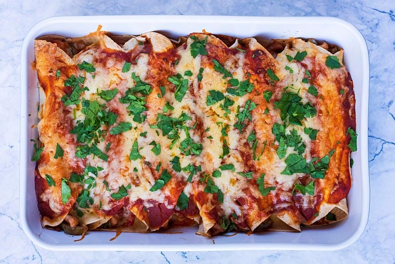 Baked enchiladas with chopped cilantro sprinkled on top