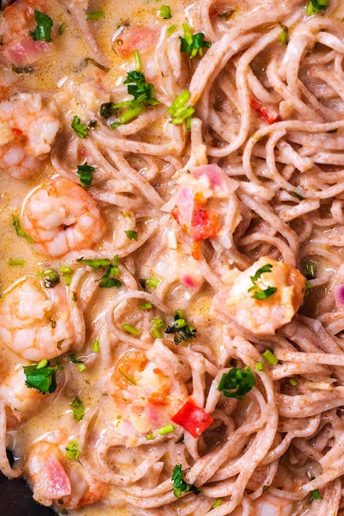 Prawns and noodles mixed into a spicy coconut broth