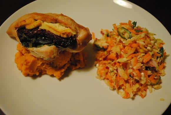 Stuffed Chicken Breast on a white plate with sweet potato mash