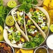 Sweet potato and black bean tacos arranged in a serving dish.