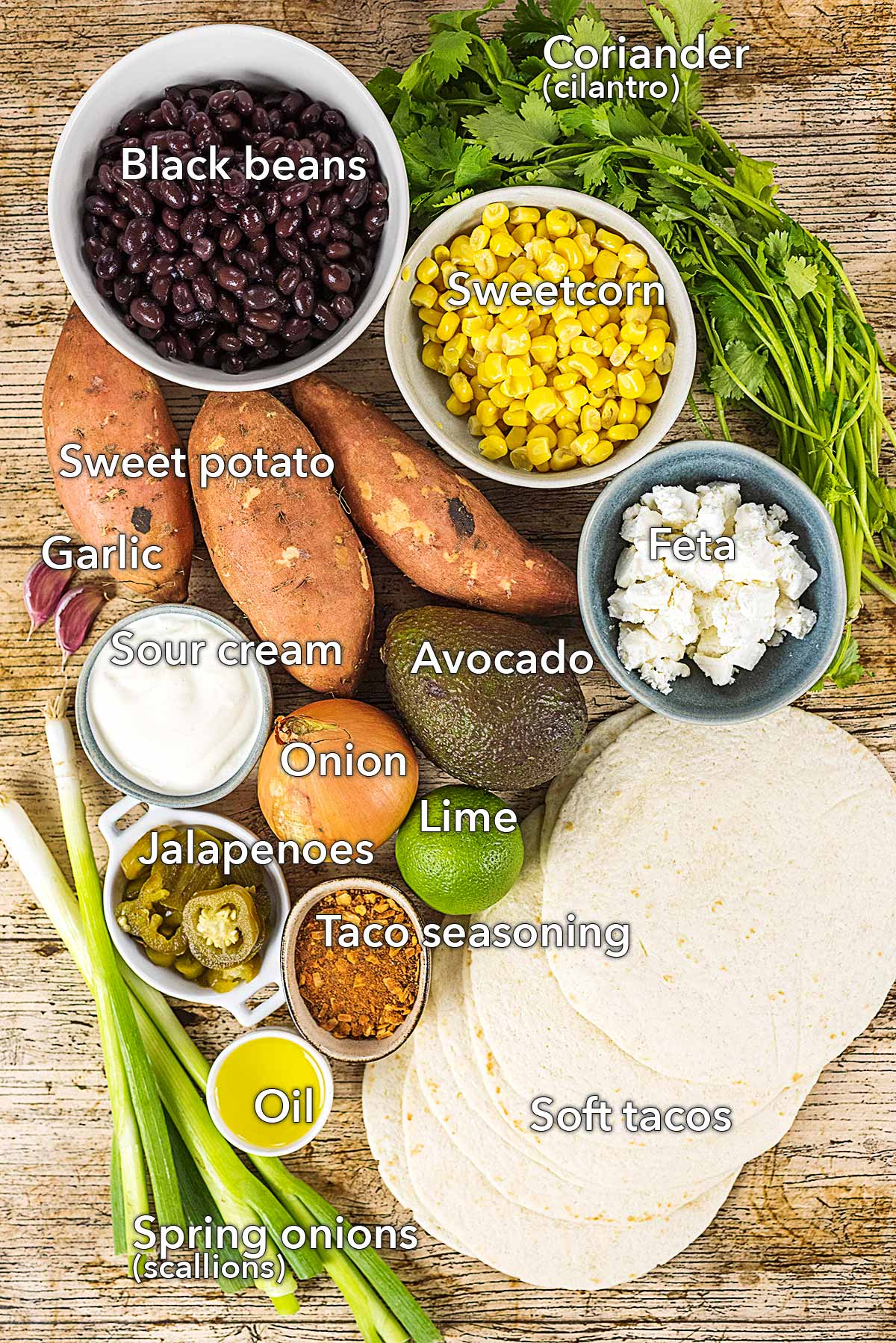 Ingredients needed to make this recipe laid out on a wooden surface.