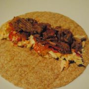 Slow Cooker Pulled Beef on a flour tortilla