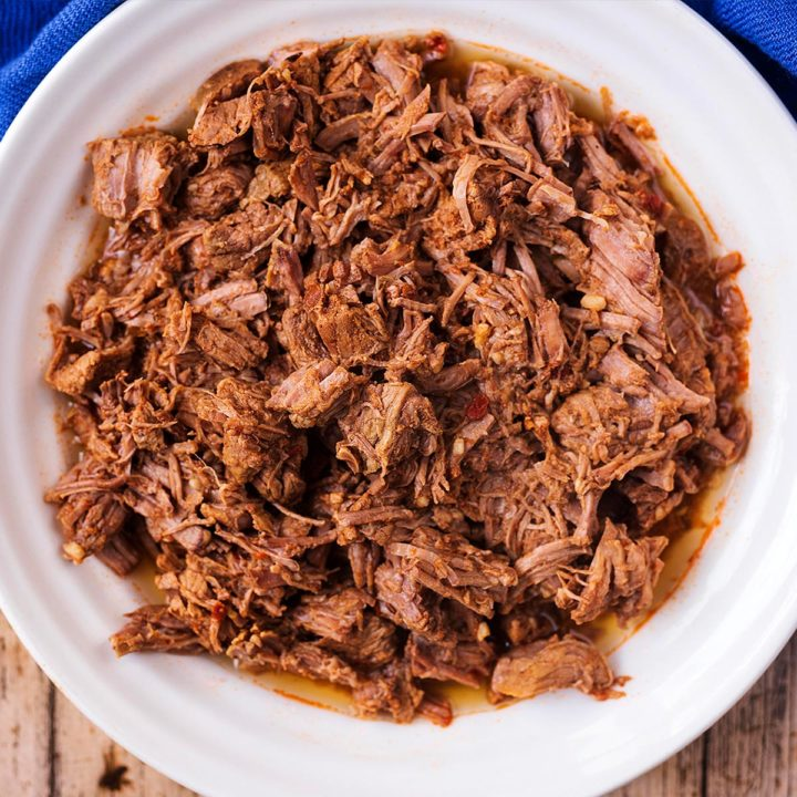 Slow Cooker Pulled Beef in a white bowl