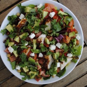 Mexican Salad in a white bowl on a wooden table