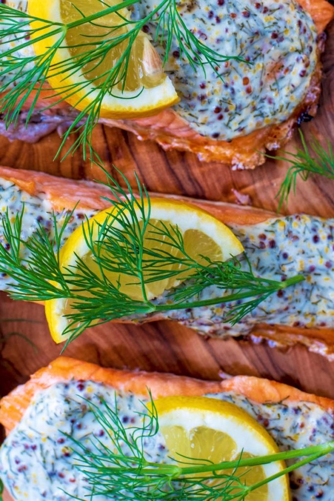 Lemon slices and dill on top of salmon fillets