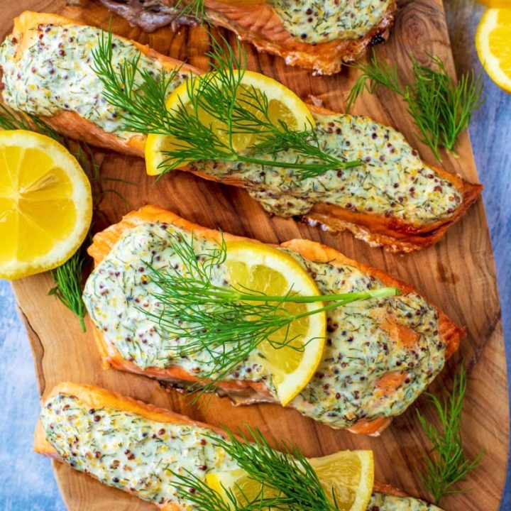 Creamy Dill Salmon topped with lemon slices and sprigs of dill