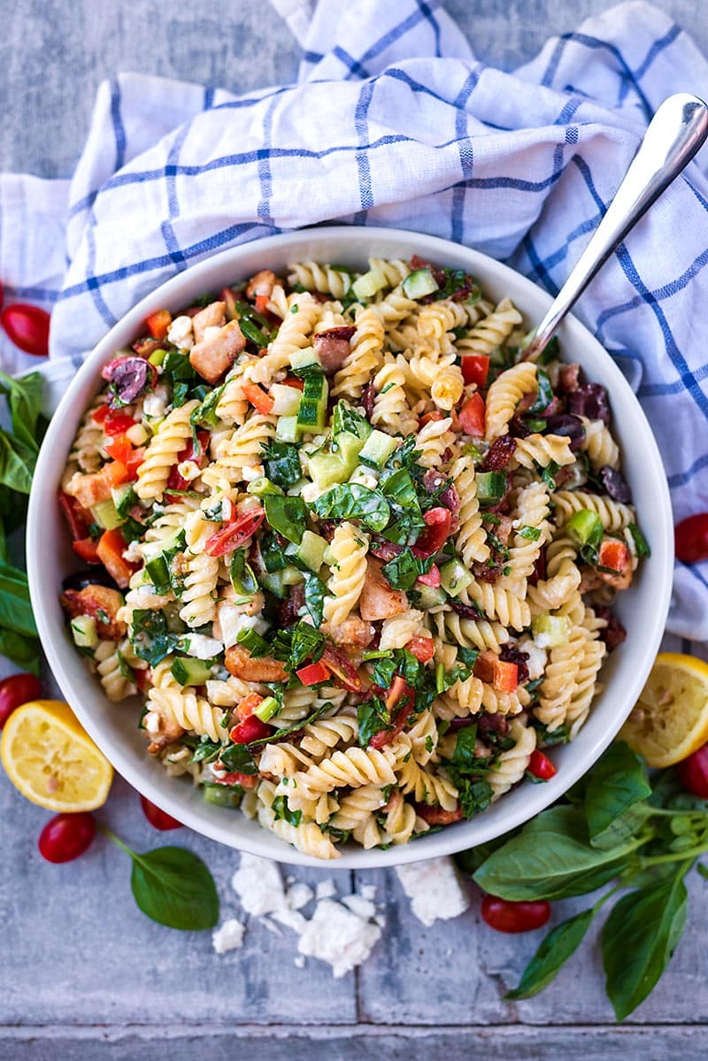 A large bowl of Chicken Pasta Salad next to a checked towel