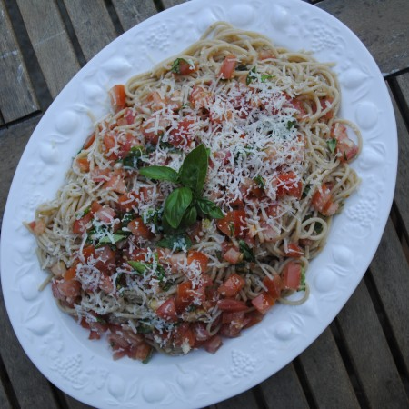A large white plate of Tomato Basil Pasta