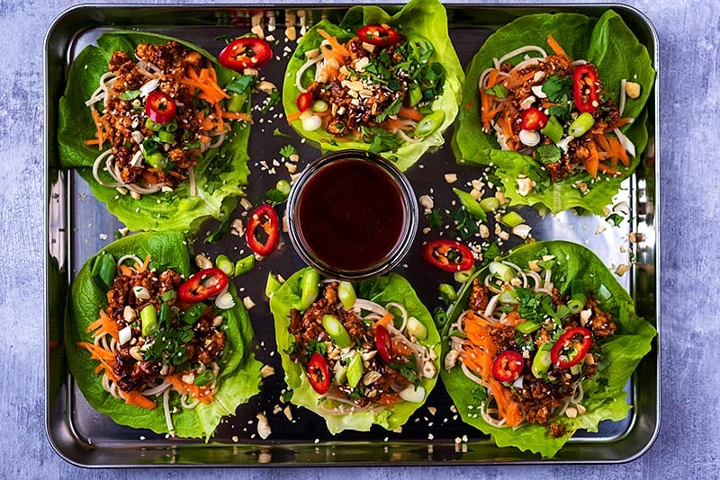 Six chicken lettuce wraps on a large silver tray