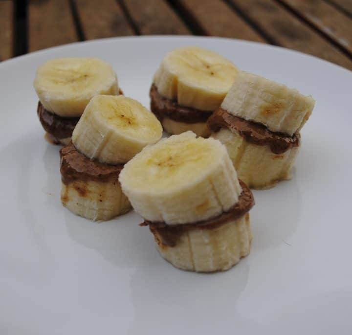 Frozen banana and nut butter on a white plate