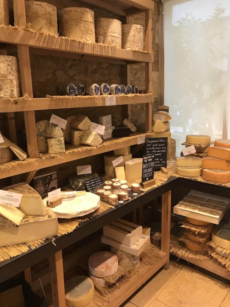 A chiller room with cheese on wooden shelves