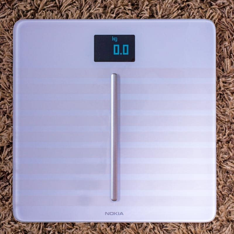 Digital scales on a brown rug