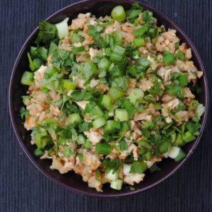 Healthy Egg Fried Rice in a purple bowl