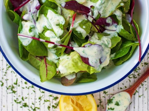 Healthy Ranch Dressing drizzled over lettuce leaves