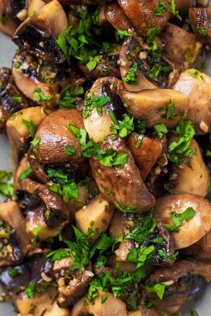 Chopped mushrooms that have been roasted and topped with a sprinkling of chopped herbs