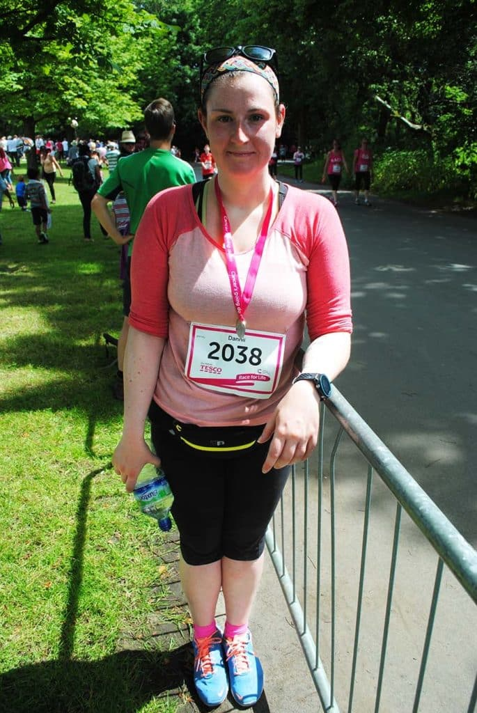 Woman standing by a barrier at Manchester's Race for Life