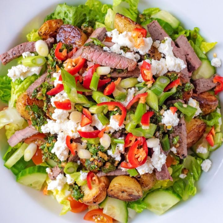 Spicy Steak and Roasted Potato Salad in a large white bowl