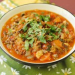 Mexican Lentil Stew in a black bowl with coriander on top