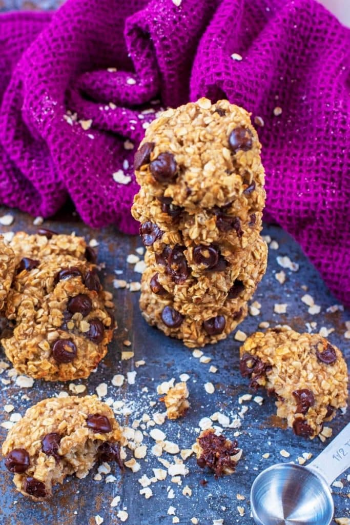 Oat cookies in a pile with oats scattered around
