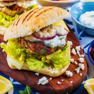 Greek Turkey Burgers on a wooden serving board