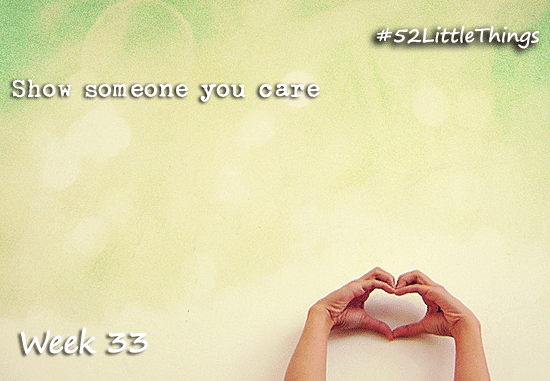 """Someone's hands forming a heart shape with text above saying """"Show someone you care"""""""