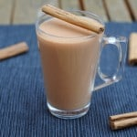 Chai Tea Latte next to some cinnamon sticks