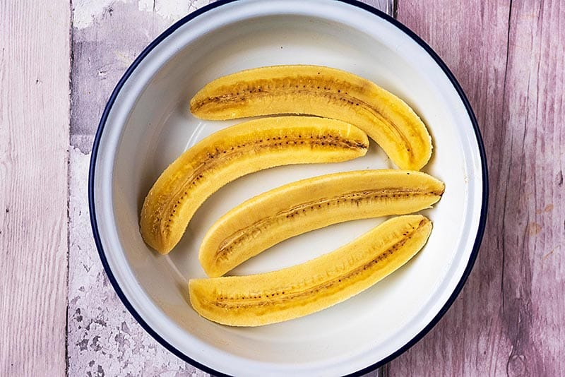 Four banana halves in a round dish