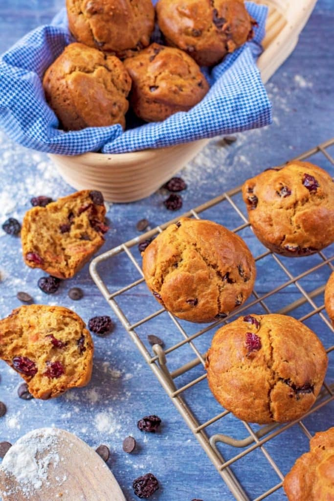 Cranberry Orange Muffins on a wire rack with more muffins in the background