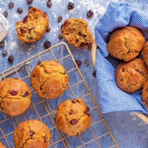 Cranberry Orange Muffins, some on a cooling rack, some in a basket