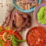 deconstructed Cajun Steak Tacos on a round serving board