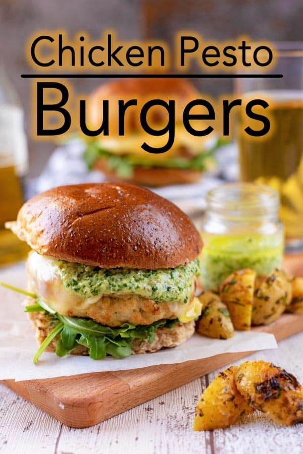 Take a classic chicken burger up a notch by mixing some pesto in to it and drizzling a creamy pesto sauce on top. If you love burgers, but are stuck in a bit or a rut or you want to make more burgers at home then give these Chicken Pesto Burgers a try! #chickenburger #burger #pesto #pestoburger #bestburger