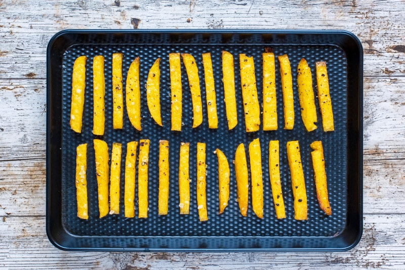 Oven Baked Polenta Fries on a black baking tray
