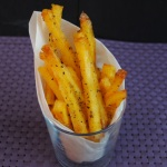 Baked Polenta Fries in a paper lined glass