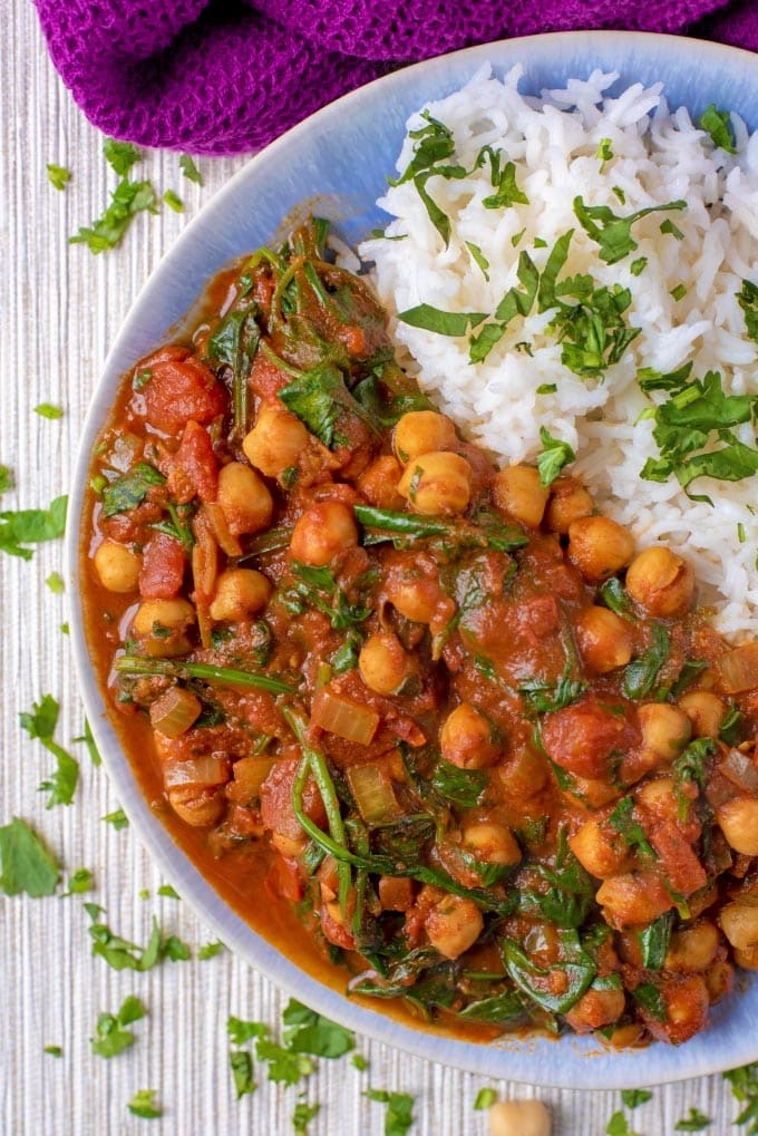Curried chickpeas and rice on a blue plate